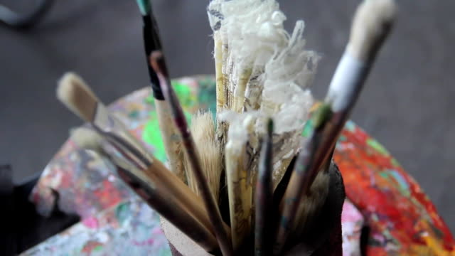 artist's brushes and vintage fan video