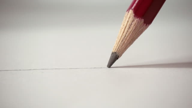 Artists hands drawing pencil writes line on paper