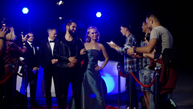 artists on red carpet with fans and photographers - adulazione video stock e b–roll