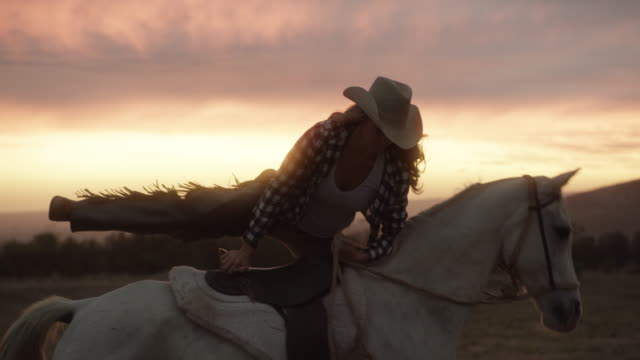 As long as you always get back up 4k video footage of a young woman riding a horse on a ranch at sunset cowgirl stock videos & royalty-free footage