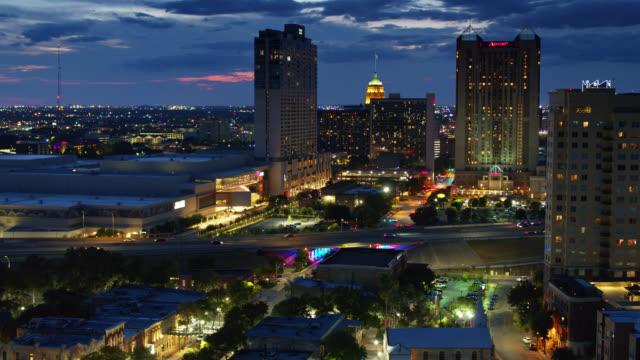 ascending aerial establishing shot of san antonio, texas at twilight - san antonio texas stock videos & royalty-free footage