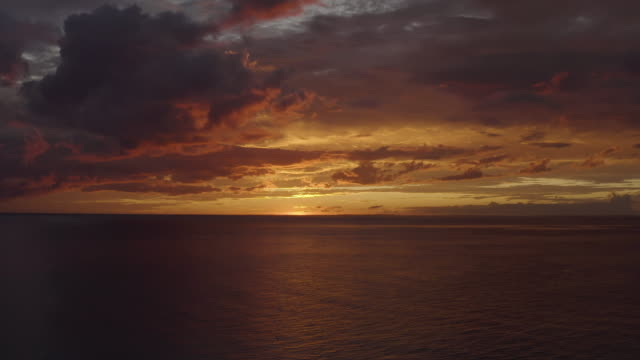 Ascending aerial shot of a sunset over the ocean near Grand Turk Island in Caribbean Flying over the ocean in Caribbean 4k stock videos & royalty-free footage