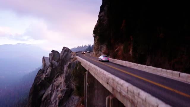 Ascending Aerial Shot of Highway 50 Crossing a Ravine in the Sierra Nevada video