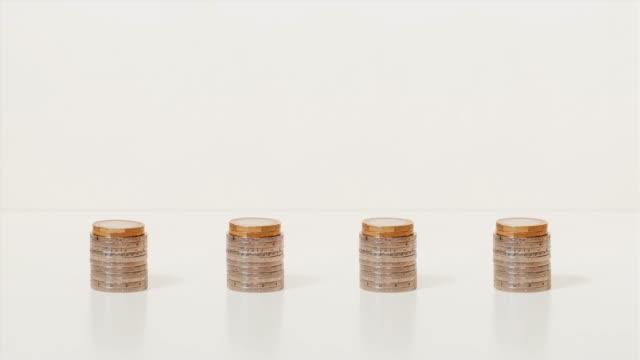 vídeos de stock e filmes b-roll de ascending graph on stop motion coins - fazer dinheiro