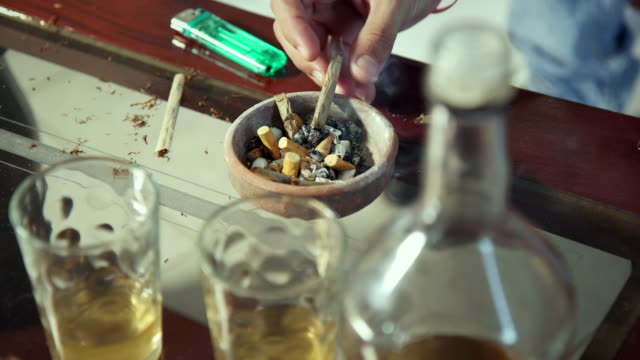 Ashtray Liquor Bottle Drugs Cigarettes And Joints On Home Table video