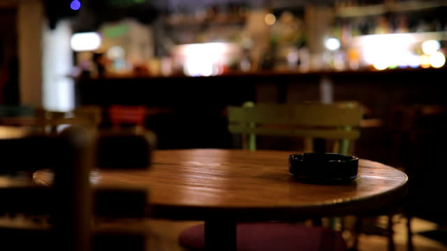 Ashtray on table in pub Ashtray on table in empty pub, no people. bar counter stock videos & royalty-free footage