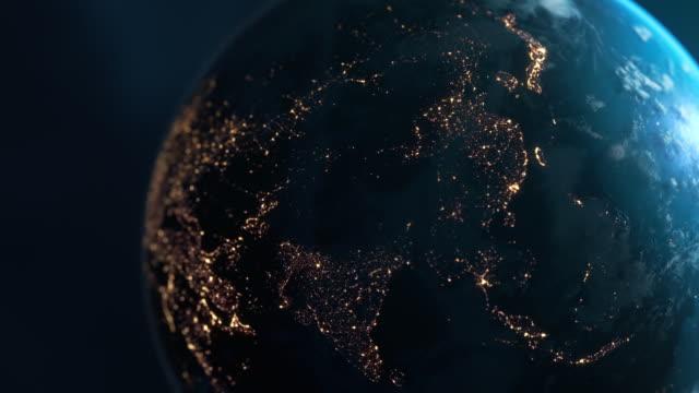 азия ночью - планета земля, увиденная из космоса - континент географический объект стоковые видео и кадры b-roll