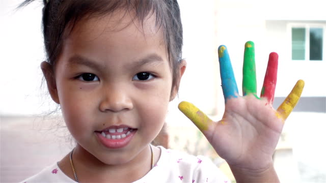 asia children showing her hand with painting in house. child crafts in leisure time. - cinque oggetti video stock e b–roll