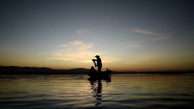 Asia Fishermen fishing at lake video