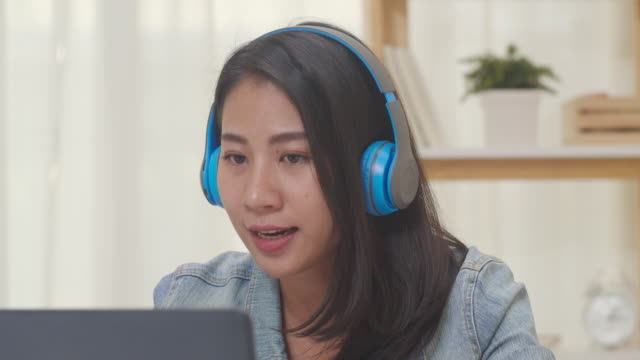 Asia freelance business women casual wear using laptop working call video conference with customer in living room at home.