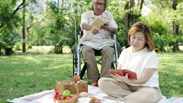 asia grandmother and grandfather relaxed at the park.slow motion - nonna e nipote camminare video stock e b–roll