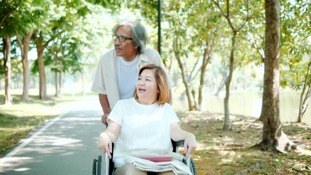 asia grandmother and grandmother walking in park on holiday. - nonna e nipote camminare video stock e b–roll
