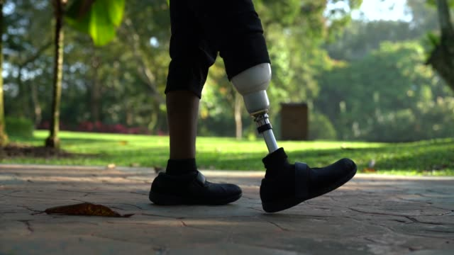 asia indian female Amputee with prosthetic leg walking at public park asia indian female Amputee with prosthetic leg walking at public park artificial limb stock videos & royalty-free footage