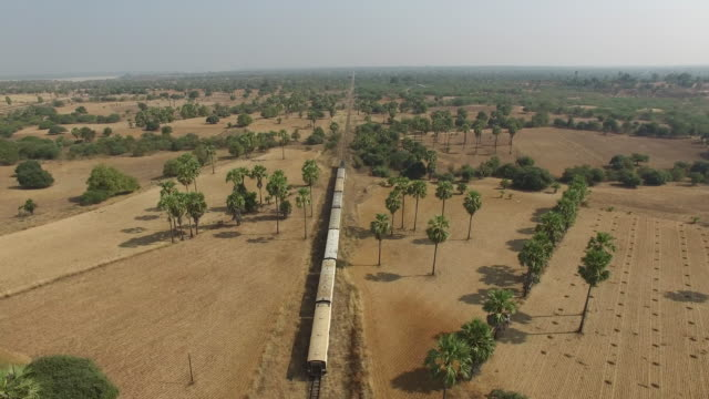 asia old train. yangon to bagan. backside drone flying shooting vodeo. - burma home do стоковые видео и кадры b-roll