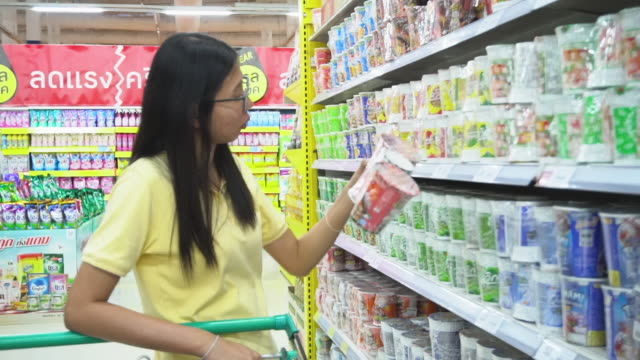 Asia woman and shopping in supermarket Asia woman and shopping in supermarket snack aisle stock videos & royalty-free footage