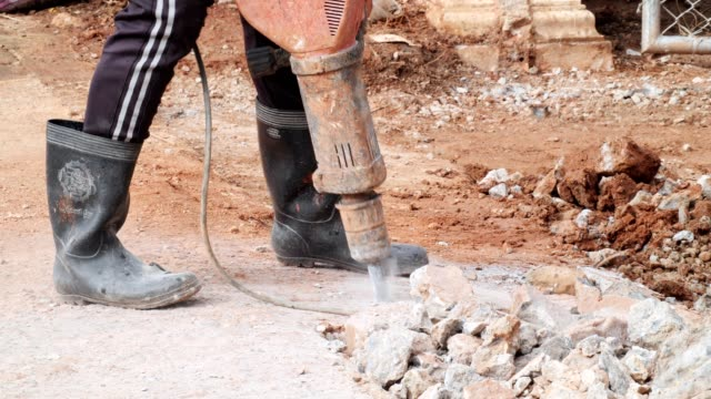 Asia worker during used electric jackhammer to break concrete floor,civil construction concept. Asia worker during used electric jackhammer to break concrete floor,civil construction concept. practice drill stock videos & royalty-free footage
