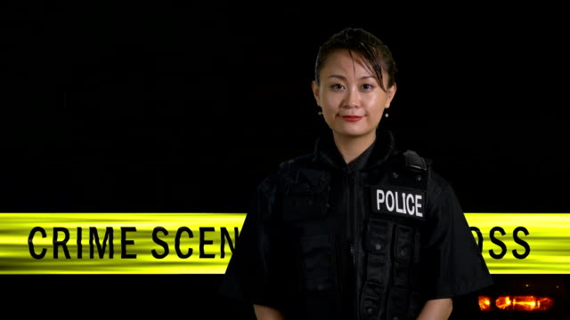 Asian American  female police officer smiling video