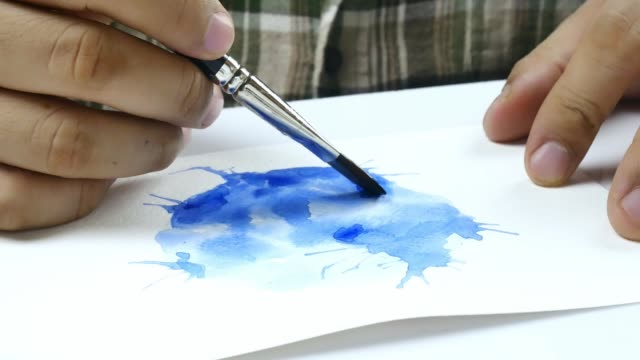 Asian artist hand Drawing watercolor on white paper