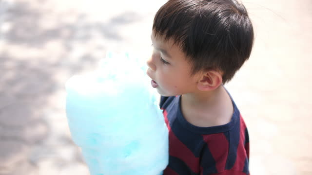Asian baby boy eating cotton candy Asian baby boy eating cotton candy cotton candy stock videos & royalty-free footage