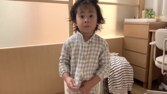 Asian baby boy gets dressed before sleep at home.