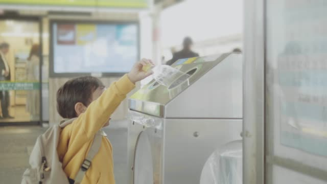 asian baby boy throwing out plastic bottle into recyclable bin - recycling stock videos & royalty-free footage