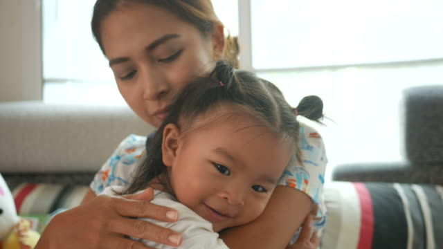Asian baby girl embracing with mother video