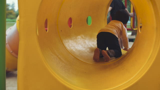 Asian baby girl is enjoying to climb and play equipment at the playground Asian baby girl is enjoying to climb and play equipment at the playground outdoor play equipment stock videos & royalty-free footage
