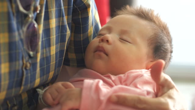 Asian baby hold in arms video