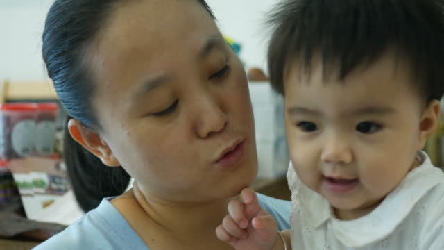 Asian baby kissing with mother video