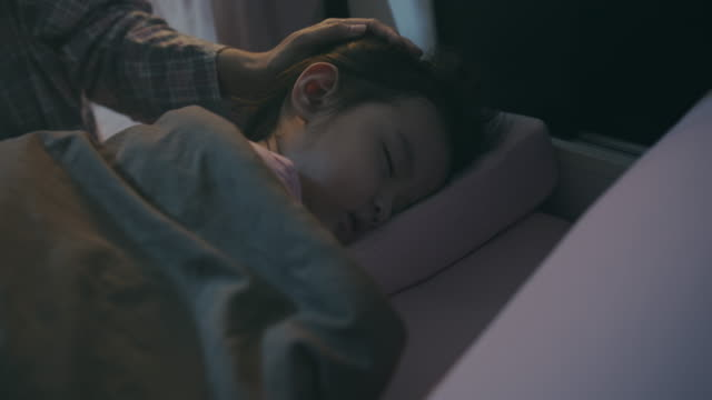 vídeos de stock e filmes b-roll de asian baby or child girl sleeping with her mother in the bedroom at night. she tired from playing all day - baby super hero