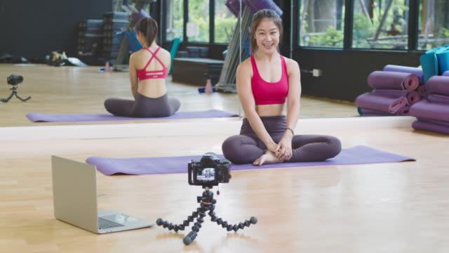 Asian Beautiful woman teaching yoga online