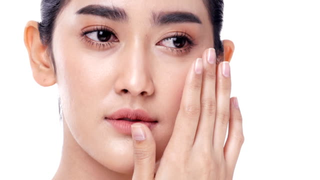 asian beautiful woman touching her face at white background. people with beauty, makeup, health care concept. - skin care stock videos & royalty-free footage