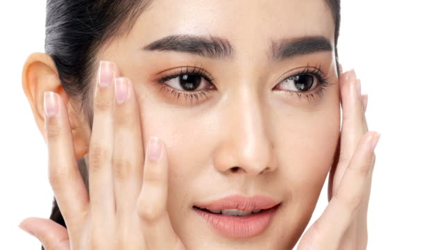 asian beautiful woman touching her face with attractive smile. - skin care stock videos & royalty-free footage