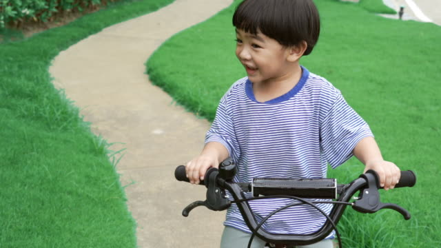 Asian boy riding bicycle video