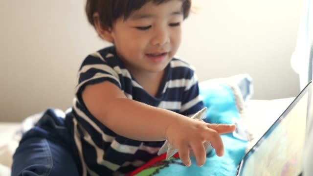 Asian boy watching tablet