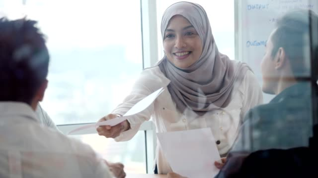 asian business people attend meeting in board room - malaysia video stock e b–roll