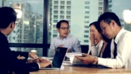 istock Asian business people discuss marketing strategy. 1187290494