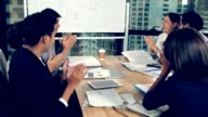 istock Asian business people discuss marketing strategy. 1187291275
