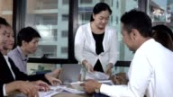 istock Asian business people discuss marketing strategy. 1205634556