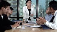 istock Asian business people discuss marketing strategy. 1205635368