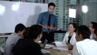 istock Asian business people discuss marketing strategy. 1205635901