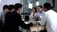 istock Asian business people discuss marketing strategy. 1205636614