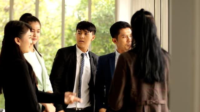 asian business people team standing talking work in office room - post it notes filmów i materiałów b-roll