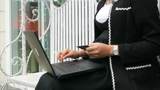 Asian business pregnant paying credit card for online shopping video