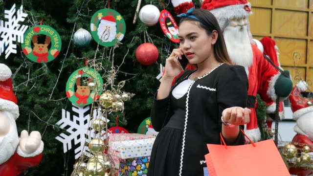 Asian business pregnant shopping Christmas ornament video