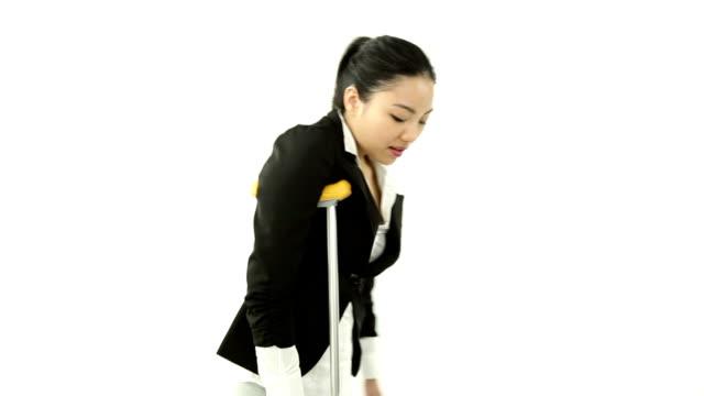 asian business woman isolated on white injured with crutch asian 20 years old girl isolated on a white background crutch stock videos & royalty-free footage