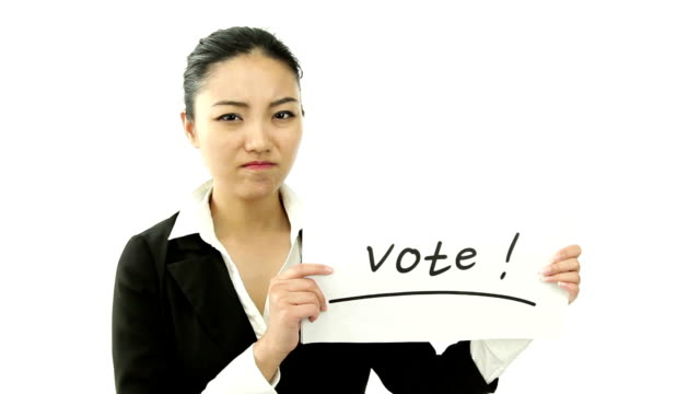 asian business woman isolated on white worried with vote sign video