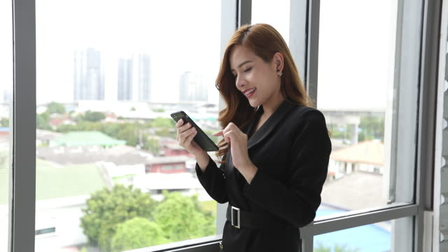 Asian business women using smartphone and tablet smiling happy for working and writing video