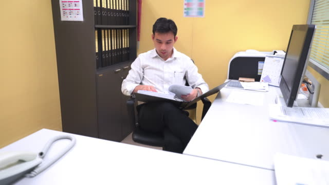 Asian businessman are reading document from files folders video