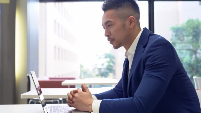Asian businessman having video conference with customer Chinese businessman having video conference with customer online meeting stock videos & royalty-free footage